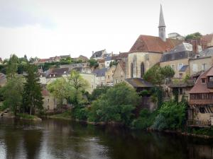 Argenton-sur-Creuse - Saint-Benoît chapel, houses, trees and river Creuse; in the Creuse valley
