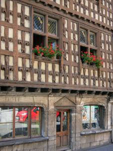 Arreau - Maison des Lys, gothic timbered and corbelled house decorated with carved lilies; in Bigorre