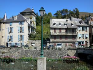 Arreau - Tower of château Ségure, lamppost and houses of the village along the river; in the Bigorre area