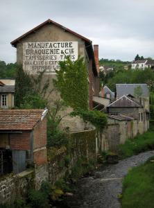Aubusson - Shop sign (banner) of a tapestry workshop, houses and a river
