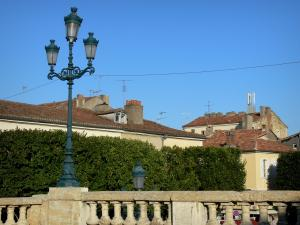 Auch - Balustrade with a lamppost and roofs of the town
