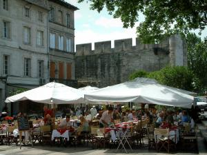 Avignon - Restaurant terrace, houses, trees and ramparts