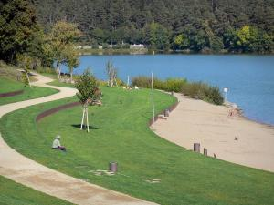 Aydat lake - Lawns, trees and beach along the lake; in the Auvergne Volcanic Regional Nature Park