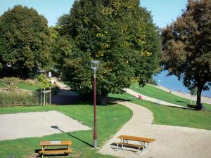 Aydat lake - Picnic tables, lamppost, lawn, trees and beach along the lake; in the Auvergne Volcanic Regional Nature Park