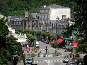 Bagnoles-de-l'Orne - View of the fountain on the Place de la Republique square and the facades of the Docteur Poulain street