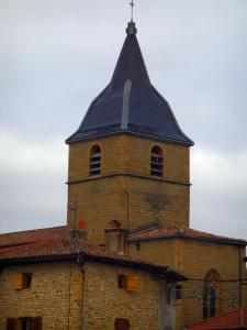 Bagnols - Stone house and church bell tower in the village in the Pierres Dorées (golden stones) area