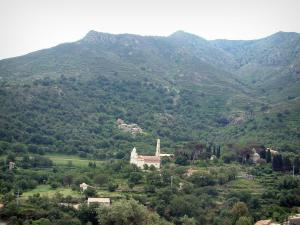 Balagne region - Church and houses surrounded by hills