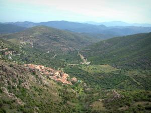 Balagne region - Hilltop village surrounded by hills covered with forests