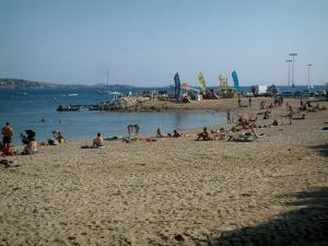 Bandol - Sandy beach of the seaside resort with tourists and the Mediterranean Sea