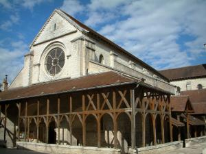 Bar-sur-Aube - Wooden covered gallery (Halloy) of the Saint-Pierre church and clouds in the blue sky
