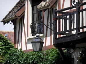 Barbizon - Lamppost, balcony of a timber-framed house