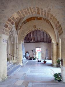 La Bastide-Clairence - Porch of the Notre-Dame de l'Assomption church and the courtyard cemetery paved with tombstones