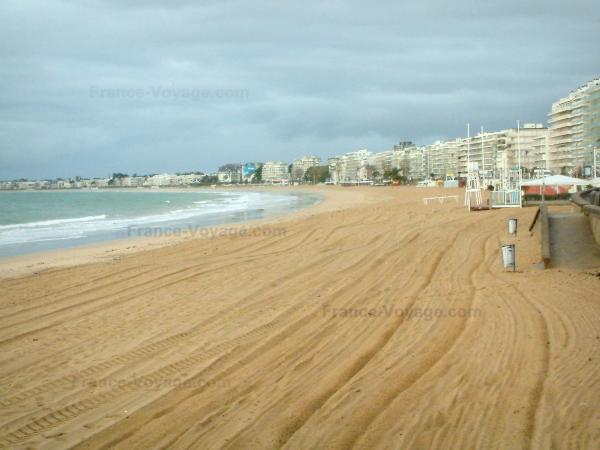 La Baule - Sandy beach, sea (Atlantic Ocean), buildings of the seaside resort and turbulent sky