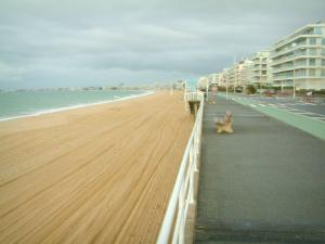 La Baule - Sandy beach, sea (Atlantic Ocean), walkway, buildings of the seaside resort and turbulent sky
