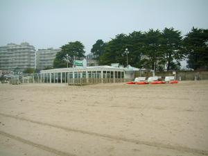 La Baule - Sandy beach of the seaside resort, trees and buildings