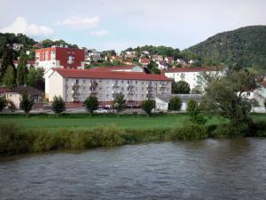 Baume-les-Dames - Bank of the River Doubs, prairie, trees, buildings and houses of the city