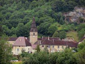 Baume-les-Messieurs - Abbey: abbatial buildings, bell tower of the Saint-Pierre abbey church and trees