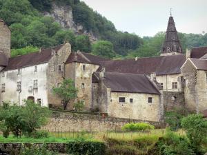 Baume-les-Messieurs - Abbey: former abbatial buildings, bell tower of the Saint-Pierre abbey church and trees