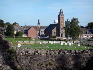 Bavay - Archeological site (Roman remains), church, houses; bell tower and town hall in background; in the Avesnois Regional Nature Park