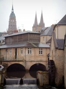 Bayeux - The former(ancient) district of the tanners and the dry cleaners: Aure river, watermill, former fish covered market hall, towers of the Notre-Dame cathedral, and houses of the old town