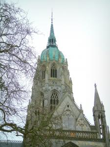 Bayeux - Central tower of the Notre-Dame cathedral of Gothic style and branches of a tree