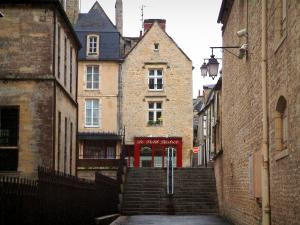 Bayeux - Stair, lampposts, restaurant, and houses in the medieval town