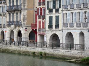 Bayonne - Arcaded facades of the Galuperie quay along River Nive