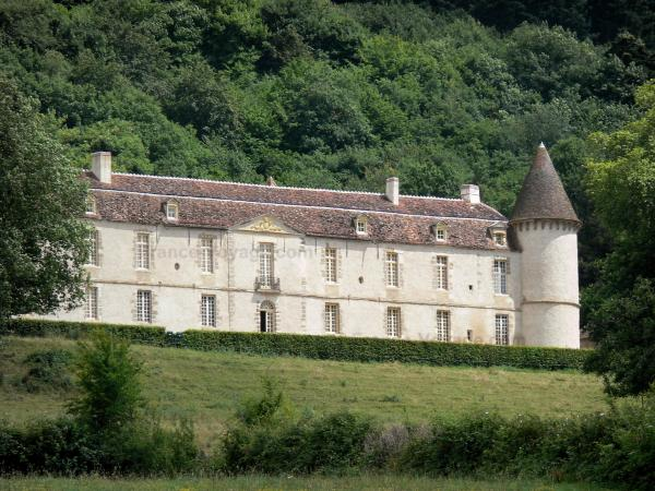 Bazoches castle - Former residence of Marshal Vauban: facade of the feudal castle surrounded by greenery; in the Morvan Regional Nature Park