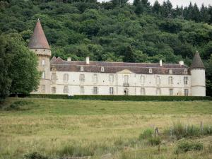 Bazoches castle - Former residence of Marshal Vauban: round towers and facade of the feudal castle, pre and trees; in the Morvan Regional Nature Park