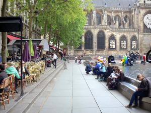 Beaubourg district - Stravinsky square with its automata fountain and café terraces; Saint-Merri church in the background
