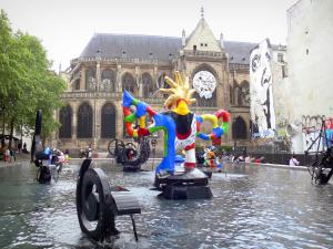 Beaubourg district - Stravinsky fontain, with its colorful sculptures, and the Saint-Merri church