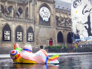 Beaubourg district - Colorful sculpture of the Stravinsky fountain and Saint-Merri church