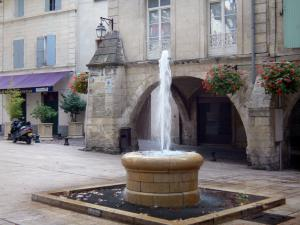 Beaucaire - Fountain, arcades and houses in the Place de la Republique