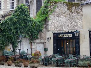 Beaugency - Terrace of a restaurant and ancient Notre-Dame abbey in background
