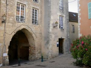 Bellême - Porch (remains of old walls) and facades of houses in the old town; in the Perche Regional Nature Park