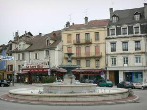 Belley - Fountain and facades of houses of the Place des Terreaux square; in Lower Bugey