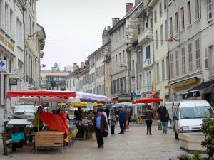Belley - Stalls of the Saturday morning market and facades of houses in the Grande Rue street