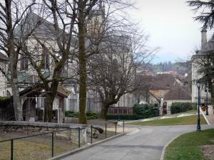Belley - Alley in the park of the episcopal palace overlooking the trees and the head of the Saint-Jean-Baptiste cathedral