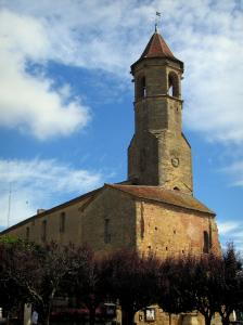 Belvès - Church of the medieval village and clouds in the blue sky, in Black Périgord