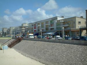 Berck-sur-Mer - Opal Coast: beach and buildings of the seaside resort, clouds in the sky