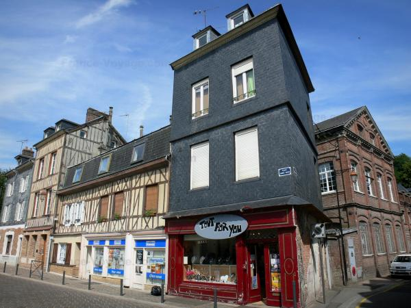 Bernay - Facades of houses and shops of the Place Sainte-Croix square