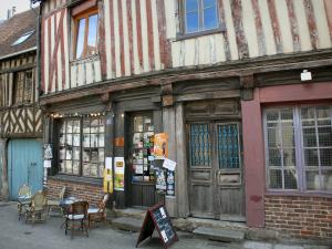 Bernay - Facades of half-timbered houses and front of a library