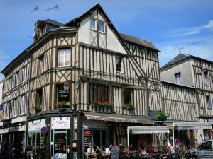 Bernay - Facades of half-timbered houses and café terrace in the Rue Thiers street