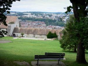 Besançon - Park of the citadel (benches, lawns, trees) with view of the Saint-Etienne citadel frontage and the roofs of the city