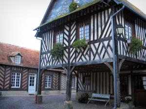 Beuvron-en-Auge - Half-timbered houses, one with wooden pillars, in the Pays d'Auge area