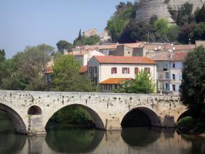 Béziers - Houses of the city, Vieux bridge spanning the Orb river, trees along the water