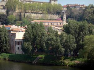Béziers - Former bishop's palace (the Palais de Justice (law courts)), Saint-Jude church, houses of the city, trees along the water and the Orb river