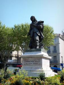 Béziers - Pierre-Paul Riquet's statue, flowers, plane trees and buildings of the city