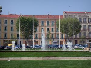 Béziers - Buildings of the city, plane trees, fountain and lawns