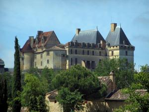 Biron castle - Castle, trees and roofs of houses, in Périgord